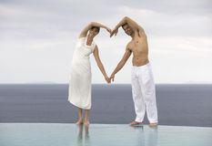 A couple forming the shape of a heart Stock Photography