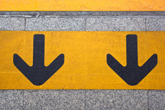 Couple forwarded yellow on the walking way. Couple forwarded yellow arrow on the road royalty free stock image