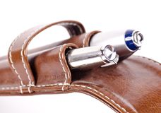 A couple of fountain pens in a leather pen case. On a white background royalty free stock images