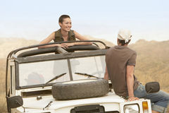 Couple In Four-Wheel-Drive Car In Desert Royalty Free Stock Photos