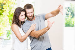 Couple framing a picture with hands Stock Photography