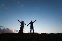 Couple freedom blue sky silhouette. Man and women express success freedom on wood texture blue sky stock photos