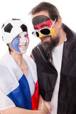 Couple of french and german soccer fans shaking hands Royalty Free Stock Image