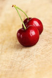 A couple of fresh cherries, bright colours Stock Photography