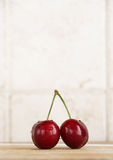 A couple of fresh cherries in a kitchen Royalty Free Stock Photography