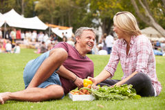 Couple With Fresh Produce Bought At Outdoor Farmers Market Royalty Free Stock Photography
