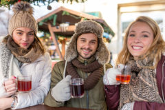 Couple and Friend drink Mulled Wine on the Christmas Market Royalty Free Stock Photo