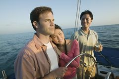 Couple with friend relaxing on yacht Royalty Free Stock Image