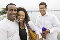 Couple with friend on yacht stock photo