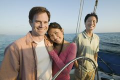 Couple with friend on yacht Stock Photography