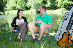 Couple of friends on a camping Royalty Free Stock Images