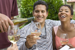 Couple And Friends Celebrating With Wine Royalty Free Stock Image