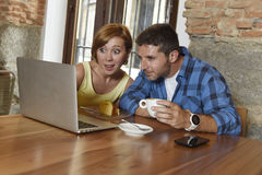 Couple or friends at coffee shop working with laptop computer in the morning happy Stock Image