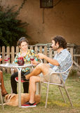 Couple of friends drinking outdoors Stock Photography