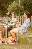 Couple of friends drinking sangria outdoors Stock Photos