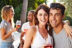 Couple With Friends Drinking Wine And Relaxing Outdoors Royalty Free Stock Photo