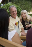 Couple And Friends Enjoying Together Royalty Free Stock Image