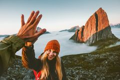 Couple friends giving five hands traveling outdoor. Hiking in Norway mountains adventure lifestyle positive emotions concept family together on journey stock photography