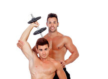 Couple of friends lifting weights Stock Image