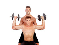 Couple of friends lifting weights Royalty Free Stock Photo