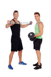 Couple of friends lifting weights Stock Photography