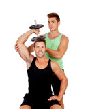 Couple of friends lifting weights Royalty Free Stock Images
