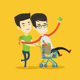 Couple of friends riding by shopping trolley. Stock Photography