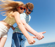 Couple friends showing thumb up gesture Stock Image