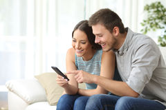 Couple or friends using a mobile phone Royalty Free Stock Photo
