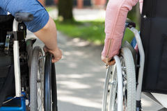 Couple of friends on a wheelchair Royalty Free Stock Photos