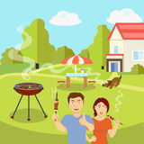 The couple fries barbecue near the country house Royalty Free Stock Photos