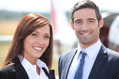 Couple in front of airplane Stock Photos