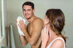 Couple in front of bathroom mirror Stock Photos