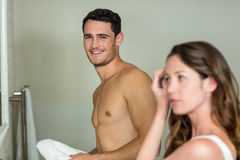 Couple in front of bathroom mirror Royalty Free Stock Image