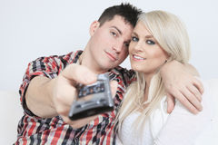 A couple in front of a big tv screen Stock Photo