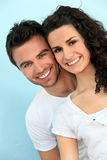 Couple in front of blue wall Royalty Free Stock Photos