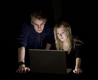 Couple in front of a computer stock images