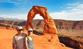 Couple in front of Delicate Arch Stock Images
