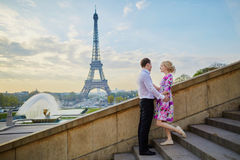 Couple in front of the Eiffel tower in Paris, France. Beautiful romantic couple in front of the Eiffel tower in Paris, France Royalty Free Stock Image