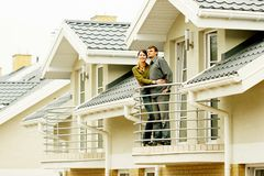 Couple in front of family house stock photography