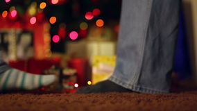 Couple in front of the gifts and Christmas tree. stock video
