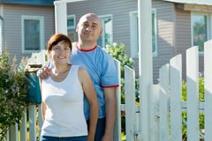Couple in front of  home Stock Image