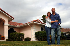 Couple in front of home Stock Photo