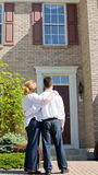 Couple in Front of Home Stock Photography