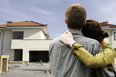 Couple in  front of house Stock Photos