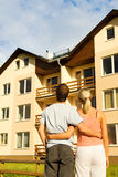 Couple in front of the house Stock Images