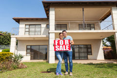 Couple in front house Stock Photos