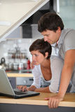 Couple in front of laptop computer Royalty Free Stock Photo