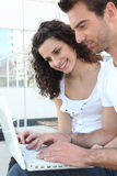 Couple in front of laptop computer Royalty Free Stock Image