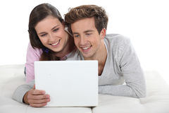 Couple in front of laptop Stock Photo